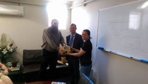 Glen Deller, Centrepoint Operations Manager receiving the AED from Nicole of First AId Tamworth and Greg Thomas of Rotary Club of Tamworth West.